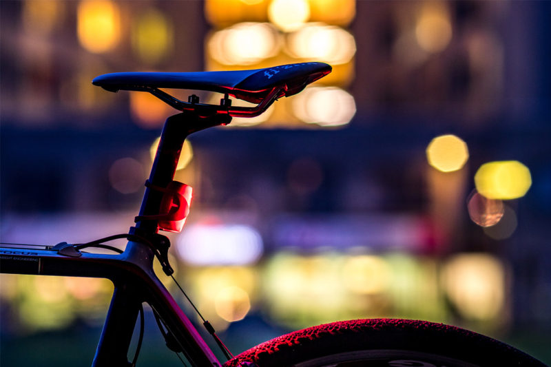 Bicycle with lights in the background